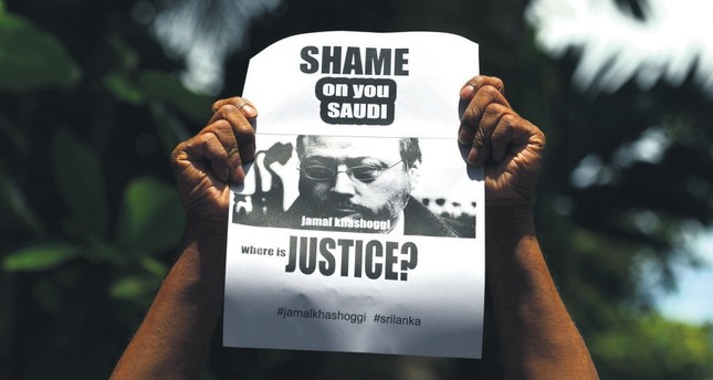 A man holds a poster with the image of Saudi journalist Jamal Khashoggi during a demonstration outside the Saudi Embassy in Colombo, Oct. 25.