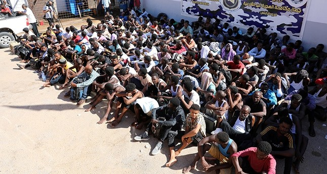 Sudanese migrants sit at a detention center before their voluntary return to their country, in Tripoli, Libya September 14, 2017. (Reuters Photo)