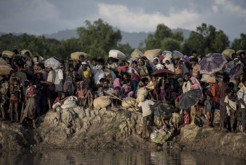 This file photo taken on October 10, 2017 shows Rohingya refugees fleeing from Myanmar arrive at the Naf river in Whaikyang, Bangladesh border. (AFP Photo)