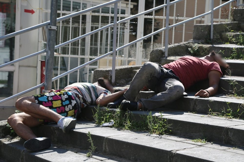 Two young men lie unconscious on the stairs in Istanbul's u015eiu015fli district after using bonzai. Bonzai is a cheap and popular drug, especially among the youth.