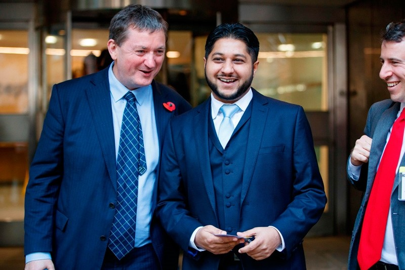 Former Uber drivers James Farrar (L) and Yaseen Aslam (R) depart after the judgement of the Uber Employment Appeal Tribunal case on November 10, 2017 in central London. ( AFP Photo)