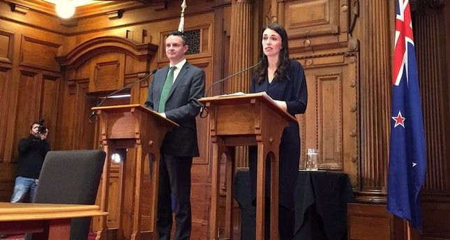 New Zealand's Prime Minister-designate Jacinda Ardern speaks as she stands next to New Zealand Green Party leader James Shaw in Wellington (Reuters Photo)