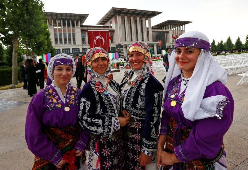 Guests dressed in traditional costumes pose for photos outside the Presidential Complex in Ankara, Turkey, in preparation for a ceremony for President Erdoğan, on Monday, July 9, 2018.