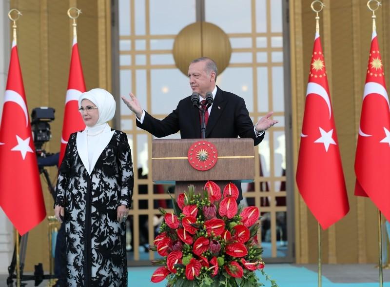 President Recep Tayyip Erdoğan, accompanied by his wife Emine Erdoğan, makes a speech during a ceremony at the Presidential Complex in Ankara, Turkey July 9, 2018.