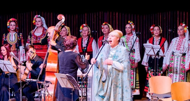 Australian-born singer Lisa Gerrard performs with Bulgaria's Grammy-winning folk choir The Mystery of the Bulgarian Voices during a concert in Varna on June 12.