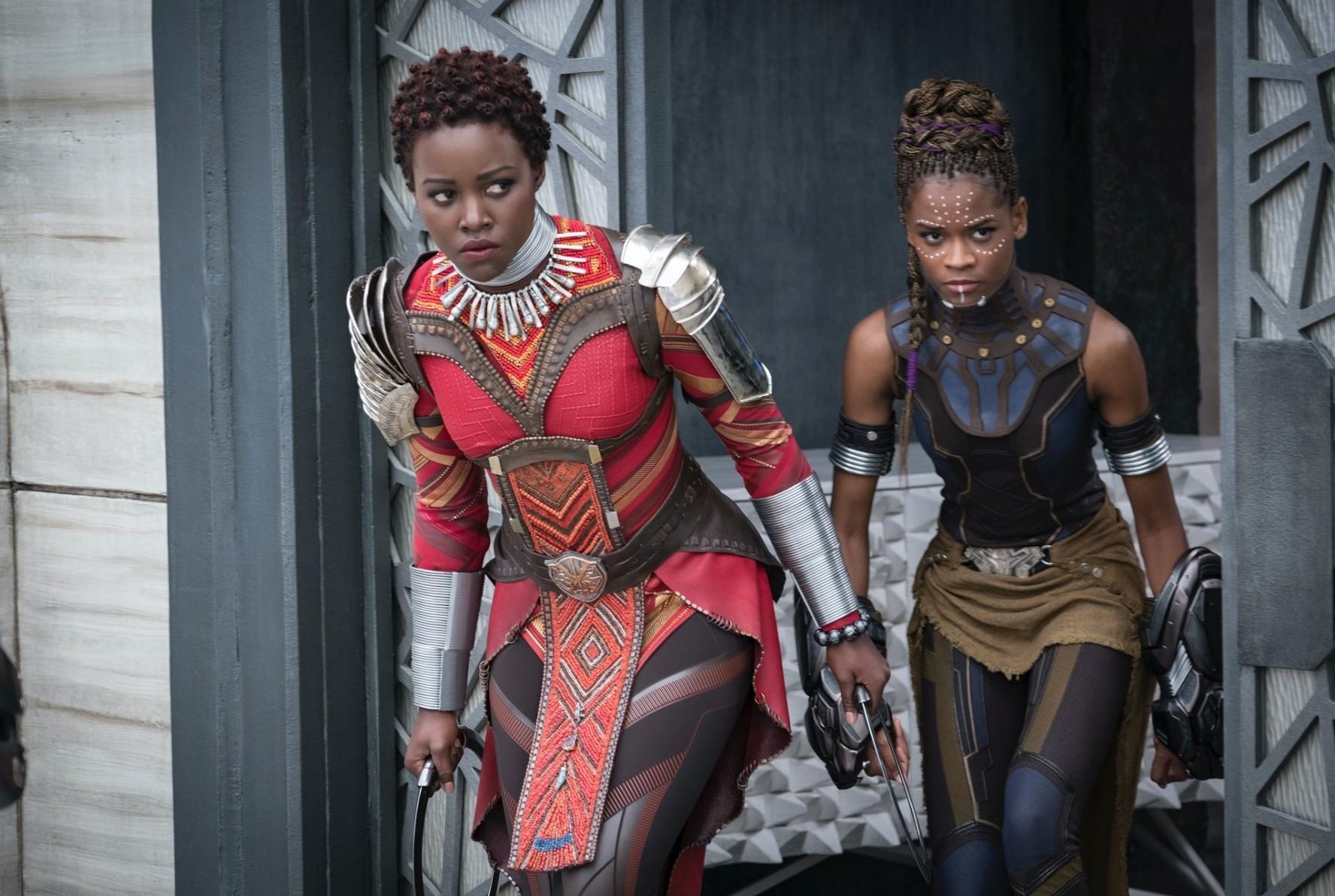 Lupita Nyongu2019o, left, and Letitia Wright in a scene from u201cBlack Panther.u201d