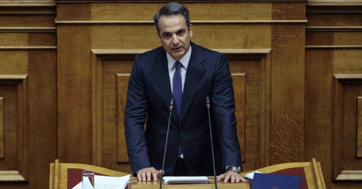 Greece's Prime Minister Kyriakos Mitsotakis addresses lawmakers during a parliamentary session to present his government's policies in Athens, Saturday, July 20, 2019. (AP Photo)