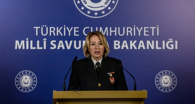 Lt. Commander Nadide Şebnem Aktop addresses reporters at the Defense Ministry HQ in Ankara on Tuesday Oct. 22, 2019 DHA Photo