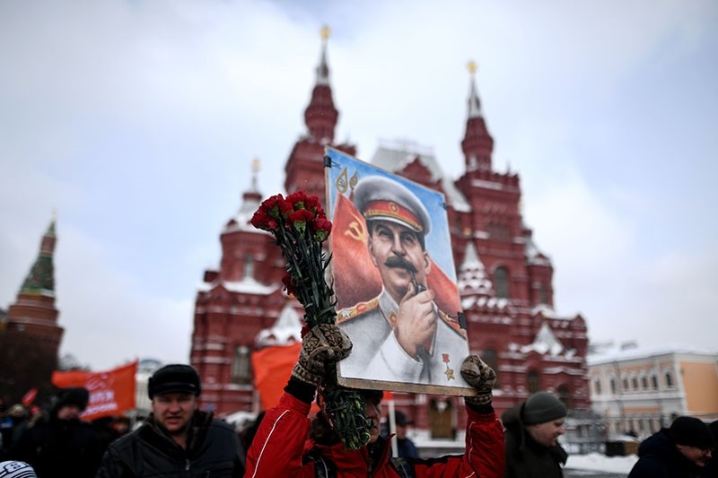 Russian Communist party supporters attend a memorial ceremony to mark the 65th anniversary of Soviet leader Joseph Stalin's death on Red Square in Moscow on March 5, 2018. (AFP Photo)