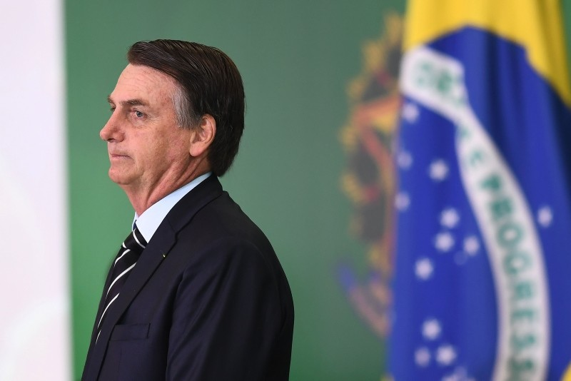 Brazilian President Jair Bolsonaro gestures during a ceremony in which some of the ministers of his cabinet take office a day after the swearing-in of the country's new government, at Planalto Palace in Brasilia, on January 2, 2019. (AFP Photo)