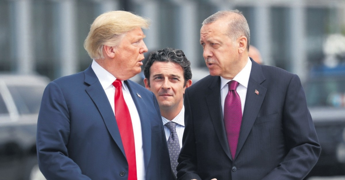 President Recep Tayyip Erdou011fan and U.S. President Donald Trump (L) talk as they walk during the start of the NATO summit in Brussels, Belgium, July 11, 2018.