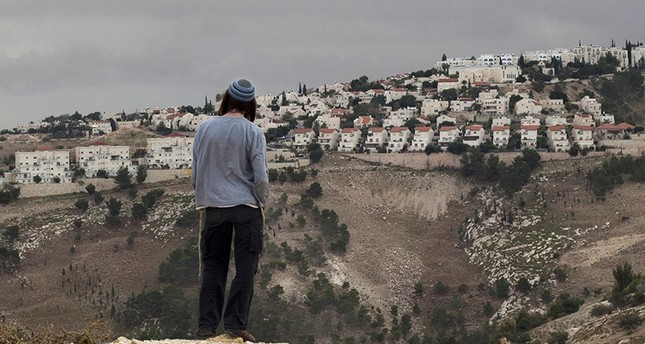 In this Dec. 5, 2012 file photo, a Jewish settler looks at the West bank settlement of Maaleh Adumim, from the E-1 area on the eastern outskirts of Jerusalem. (AP Photo)