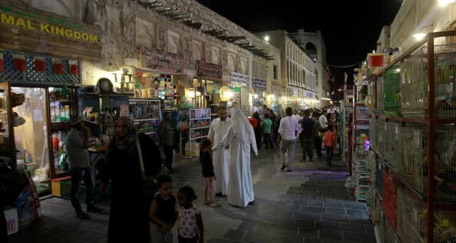 People walk at the Souq Waqif market in Doha days after Gulf nations cut diplomatic ties with Qatar, June 9.