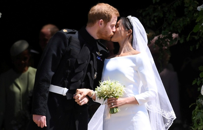 Britain's Prince Harry, Duke of Sussex and Meghan, Duchess of Sussex kiss as they exit St George's Chapel in Windsor Castle after their royal wedding ceremony, in Windsor, Britain, May 19, 2018.