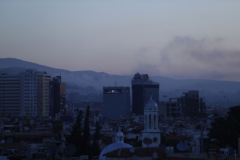Smoke rises after airstrikes targeting different parts of the Syrian capital Damascus. (AP Photo)