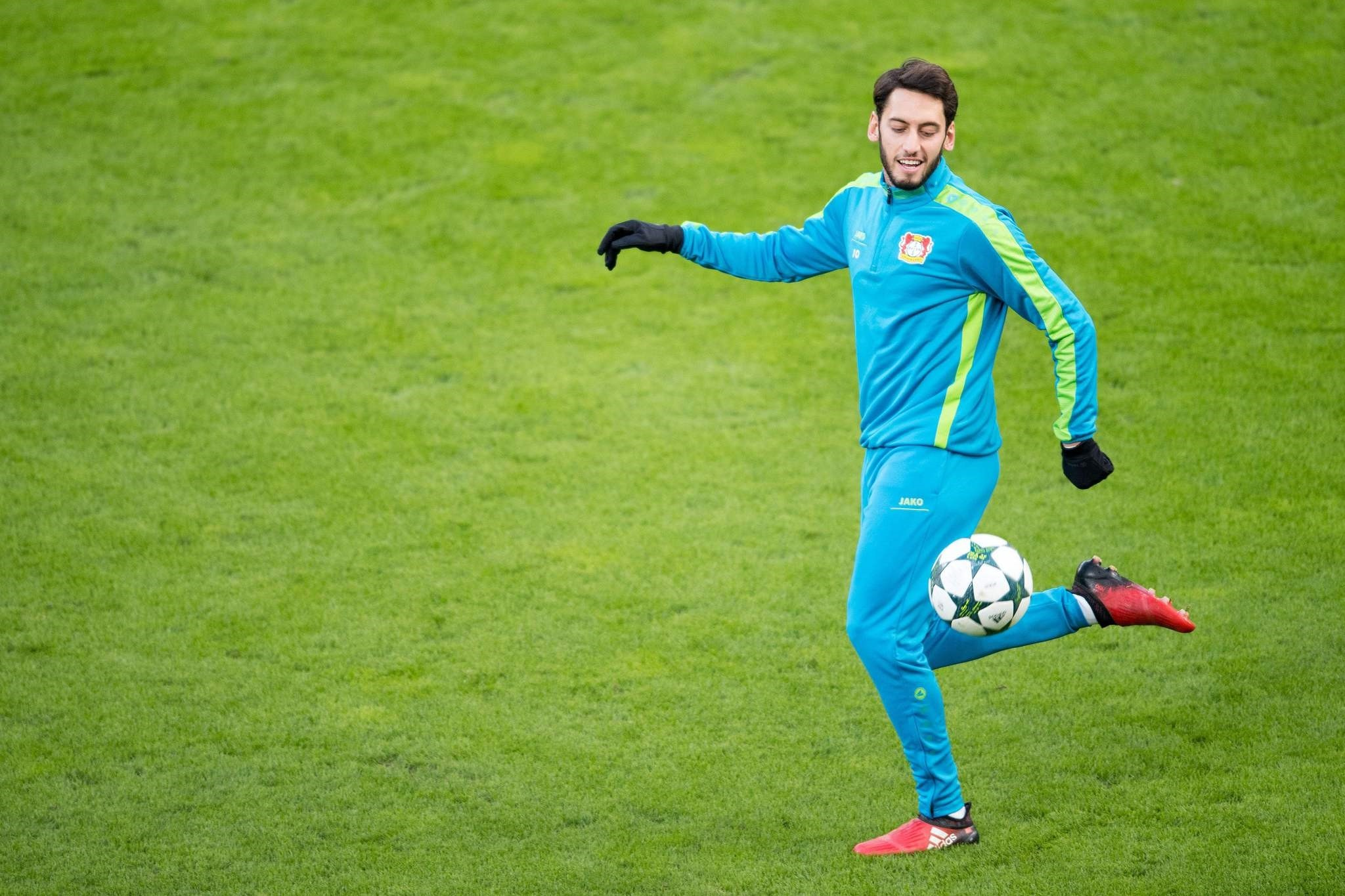Leverkusen's midfielder Hakan Calhanoglu takes part in a training session on the eve of the UEFA Champions League football. (AFP Photo)