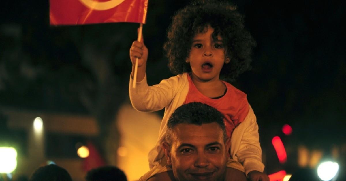 A crowd gathers on Tunis' main avenue, Sunday, Oct. 13, 2019 (AP Photo)