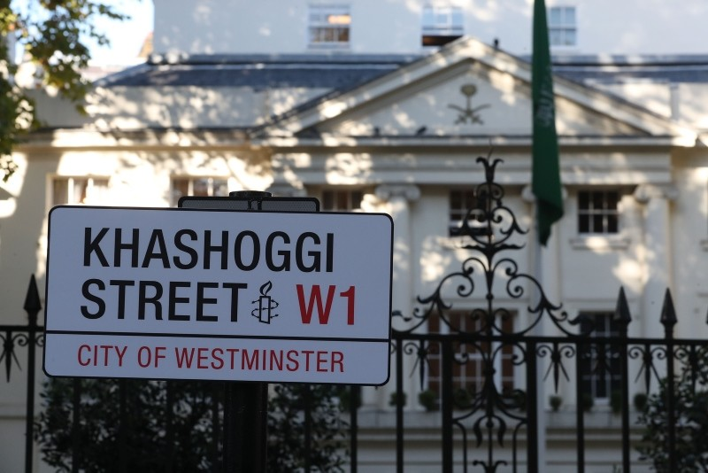 A mock street sign reading ,Khashoggi Street, is erected by Amnesty activists on the street in front of the Embassy of Saudi Arabia in London on Nov. 2, 2018 to mark one month since Khashoggi was killed in Saudi consulate in Istanbul. (AFP Photo)