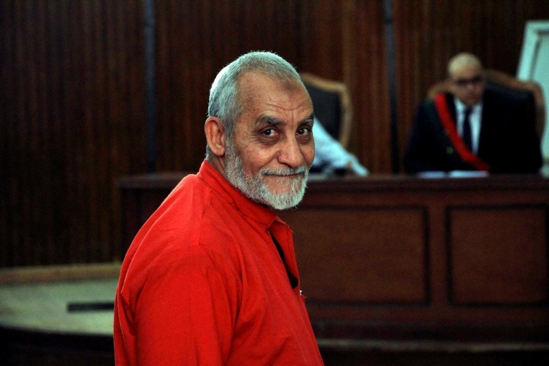 In this April 20, 2015 file photo, Muslim Brotherhood Supreme Guide Mohammed Badie wears a red jumpsuit that designates he has been sentenced to death, during a court hearing in Tora prison, Cairo, Egypt. (AP Photo/Lobna Tarek, El Shorouk Newspaper)