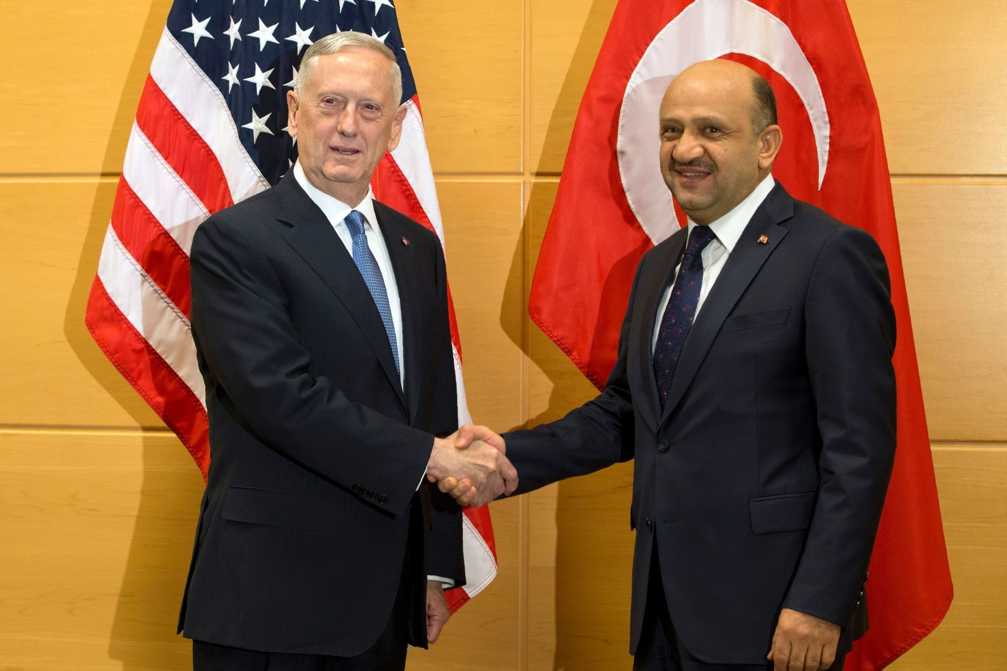 U.S. Secretary of Defense James Mattis (L) shakes hands with Turkish Defense Minister Fikri Isik during a meeting at NATO headquarters. (AFP Photo)