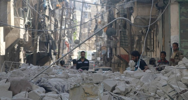 People inspect a site hit by a Syrian regime airstrike in the rebel-held area of Aleppo's al-Sukari district, Syria, May 30, 2016. (Reuters Photo)