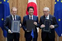 EU, Japan sign massive free trade deal