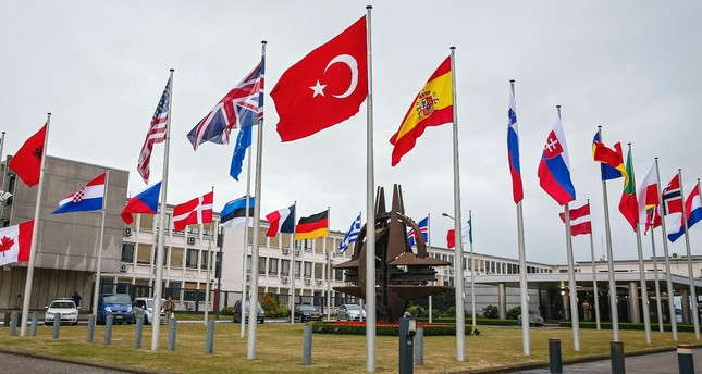 Flags of North Atlantic Treaty Organization (NATO) member countries fly in front itws headquarters in Brussels, Belgium, 28 July 2015.