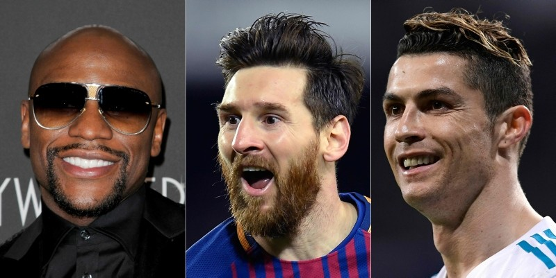 Mayweather reclaimed his place at the top of Forbes' annual ranking of the 100 highest-paid athletes, Messi was 2nd with $111 million and Ronaldo 3rd with $108 million. (AFP Photo)