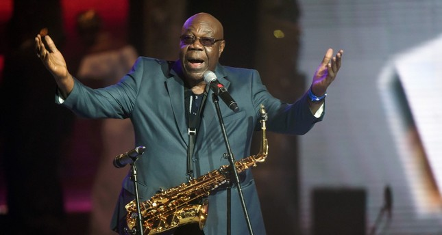 Cameroonian music legend Manu Dibango gestures as he plays during the All Africa Music Awards (AFRIMA) ceremony in Lagos in 2016.