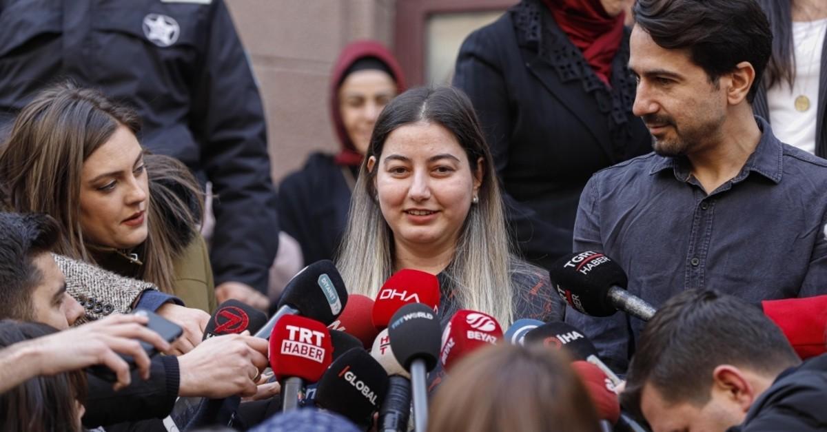 Burcu u00d6ner (C) speaks to reporters as she leaves the hospital where she has been under quarantine, Ankara, Feb. 14, 2020. (DHA Photo)