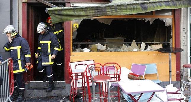 A fire swept through a Friday night birthday party at a bar in the Normandy city of Rouen, killing at least 13 people and injuring six others, French authorities said. (AP Photo)