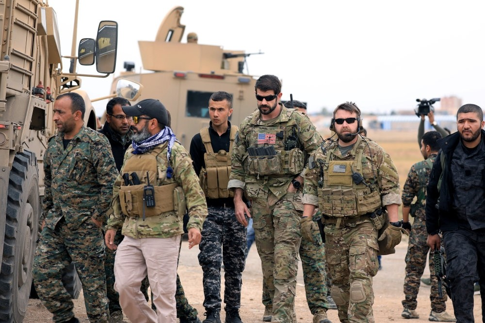 YPG militants and U.S. troops are seen during a patrol near the Turkish border in Hasakah, Syria, Nov. 4.