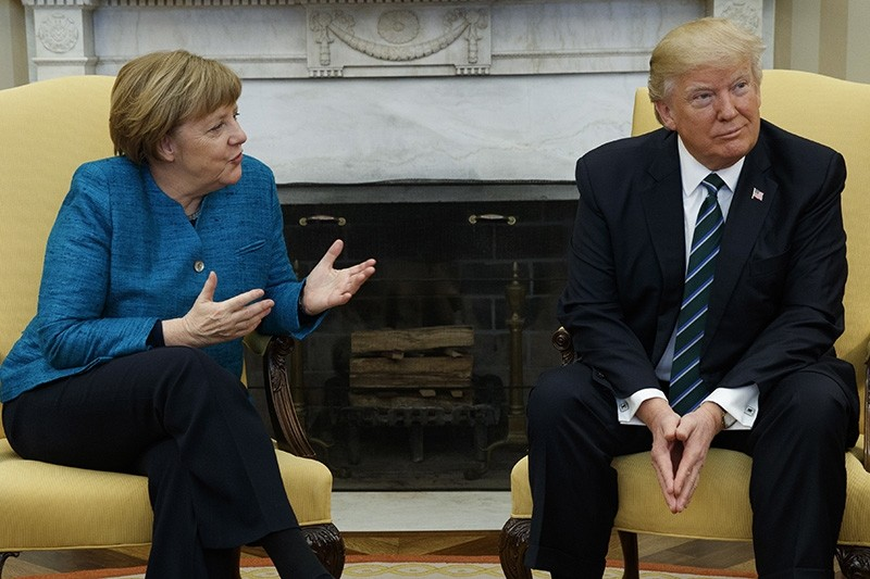 President Donald Trump meets with German Chancellor Angela Merkel in the Oval Office of the White House in Washington, Friday, March 17, 2017. (AP Photo)