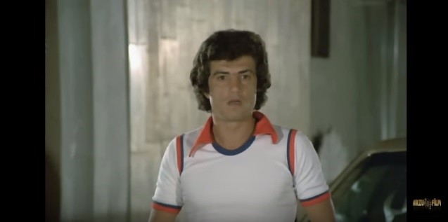 This screen-grab from the movie ,Aile u015eerefi, shows the antagonist character ,Oktay, portrayed by actor Eriu015f Akman.