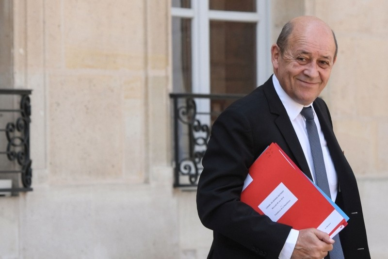 French Foreign Affairs Minister Jean-Yves Le Drian leaves the Elysee Presidential palace in Paris, on May 9, 2018, after the weekly cabinet meeting. (AFP PHOTO)