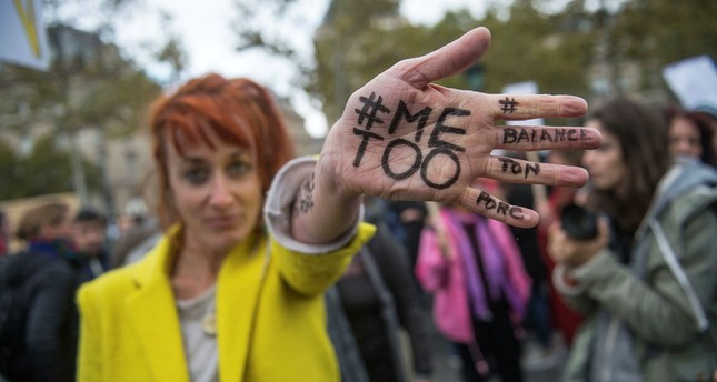 A woman shows a message reading '#MeToo - Squeal On Your Pig' written on her hand during a rally against gender-based and sexual violence against women, in Paris, France, 29 October 2017. (EPA Photo)