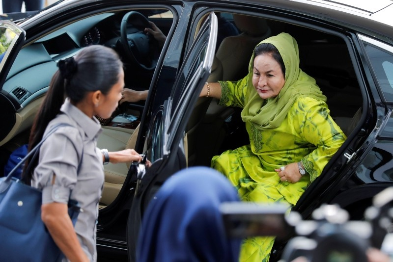 Rosmah Mansor, right, wife of Malaysian Prime Minister Najib Razak, arrives at the Anti-Corruption Agency for questioning in Putrajaya, Wednesday, Oct. 3, 2018. (AP Photo)