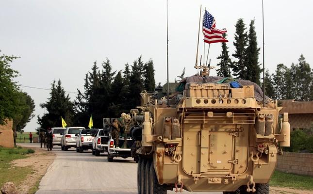 A U.S. tank follows a YPG terrorist convoy in Syria, Dec. 5, 2017.