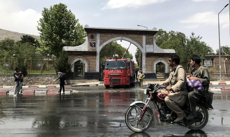 Afghan muncipality workers wash the scene after a suicide bomb attack in Kabul, Afghanistan, June 04, 2018. (EPA Photo)