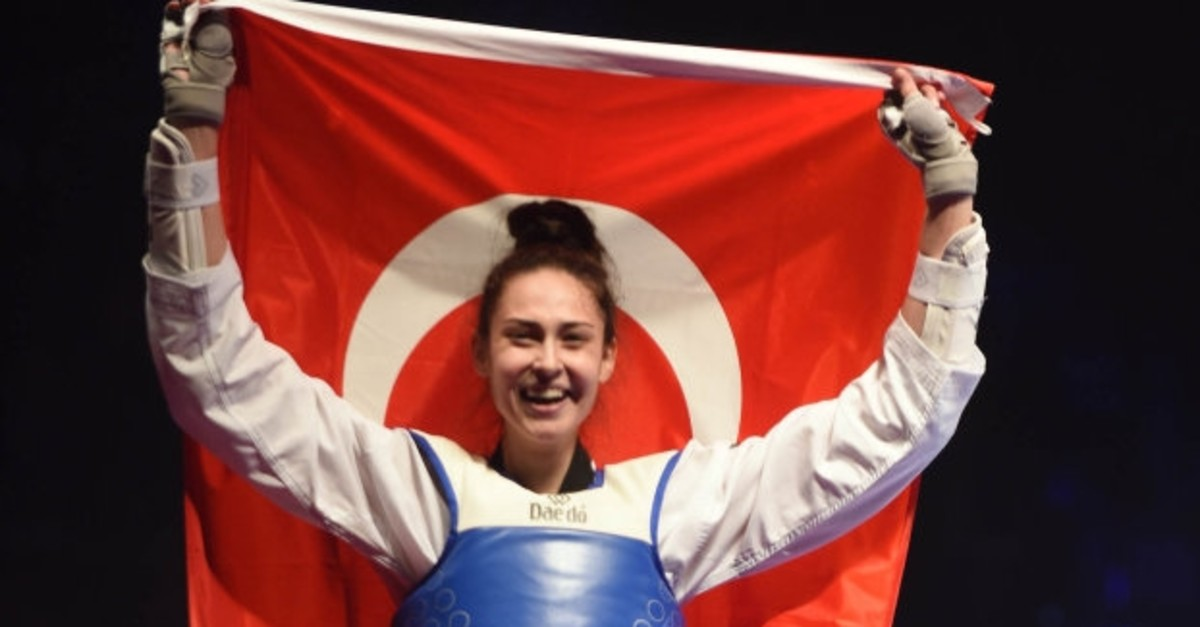 u0130rem Yaman poses with flag after her win at World Taekwondo Championship, May 19, 2019.