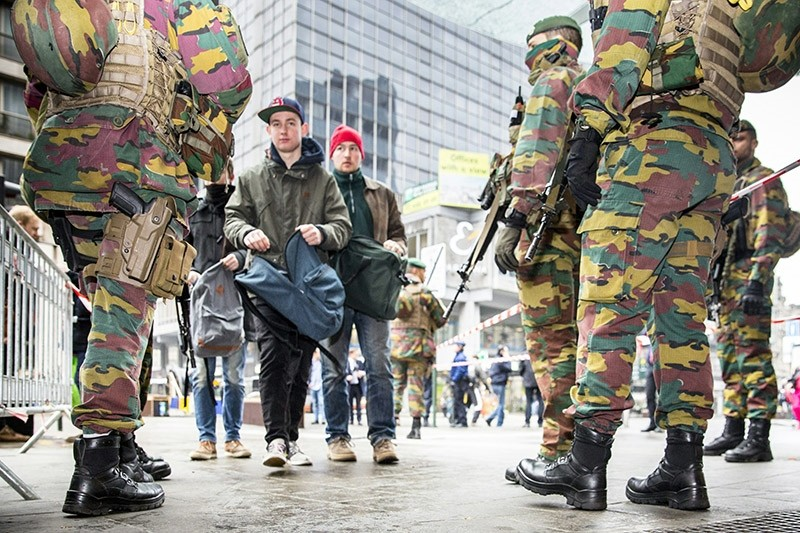 Soldiers control pedestrians in Brussels. (File Photo)