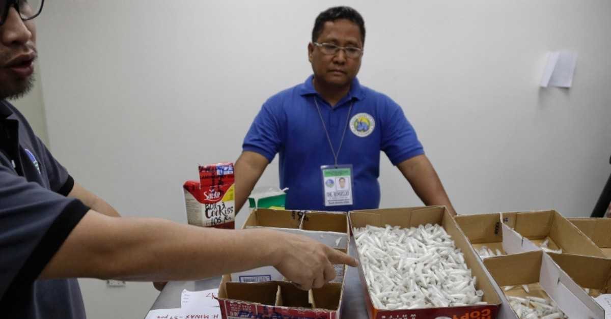 Staff of the Department of Environment and Natural Resources shows DNA sampling vials containing Tarantulas at their office in metropolitan Manila, Philippines on Wednesday, April 3, 2019 (AP Photo)