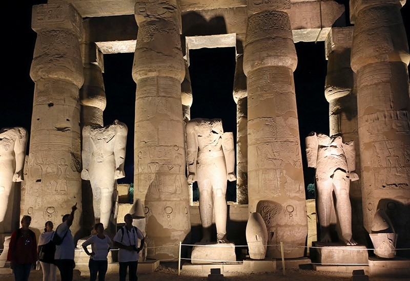 A guide explains a site for tourists at the Luxor Temple in Luxor city, Egypt, September 8, 2017 (Reuters Photo)