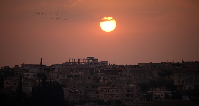 A general view shows the sun setting over a opposition-held area in the southern Syrian city of Daraa on May 28, 2018. (AFP Photo)