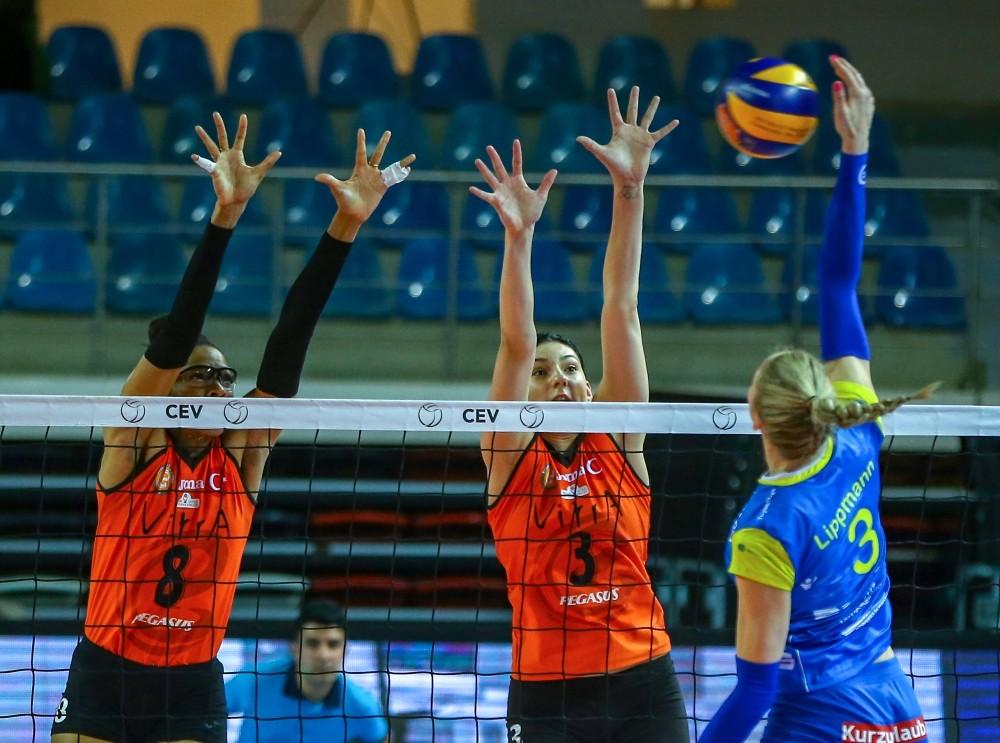 Eczacu0131bau015fu0131 VitrA defeated SSC Palmberg at Istanbul's Burhan Felek Sports Facility. Eczacu0131bau015fu0131 VitrA's Tijana Boskovic (C) and Rachael Adams (L) in action against Loissa Lippman (R) of SSC Palmberg.