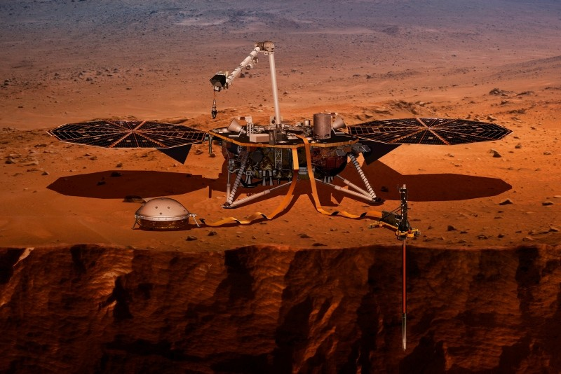Illustration shows the InSight lander drilling into the surface of Mars. InSight, short for Interior Exploration using Seismic Investigations, Geodesy and Heat Transport, is scheduled to arrive at the planet on Monday, Nov. 26, 2018. (AP Photo)