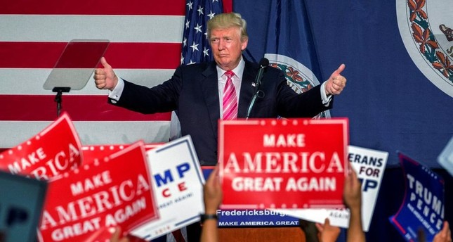 Republican presidential nominee Donald Trump delivers remarks at a campaign rally.