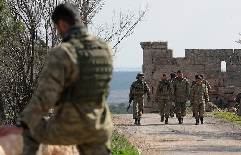Turkish soldiers prepare during an offensive, in Der Mismis village, southeast of Afrin, Syria, March 13, 2018. (EPA Photo)