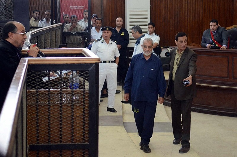 Egyptian Brotherhood's supreme guide Mohamed Badie (C) attends his trial in the capital Cairo on May 18, 2014. (AFP Photo)