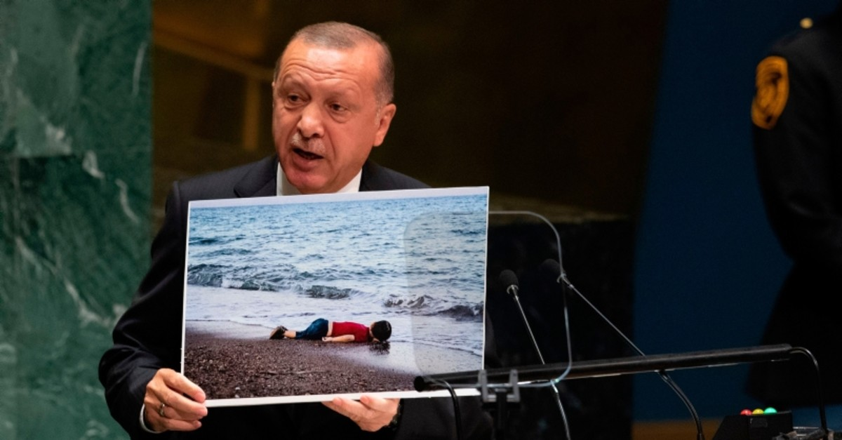 President Recep Tayyip Erdogan holds up a photo as he speaks during the 74th Session of the United Nations General Assembly at UN Headquarters in New York, Sept. 24, 2019. (AFP Photo)